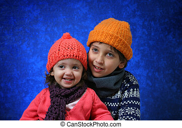 Brother and sister having fun in winter outfit. Look at my...