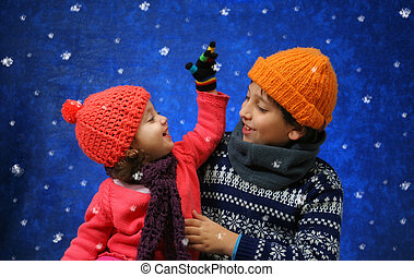 Brother and sister having fun in winter - Brother and sister...