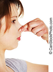 Young woman covering her nose