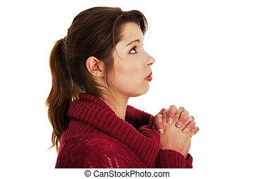 Closeup portrait of a young caucasian woman praying ,...