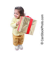 Toddler with a Christmas gift - Cute little girl with a...