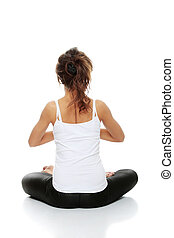 Woman doing yoga pose - Easy Pose, sanskrit name: Sukhasana...