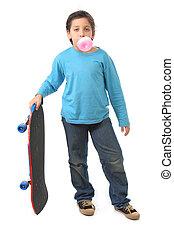 Boy blowing a bubble gum holding a skate - Bubble gum boy...