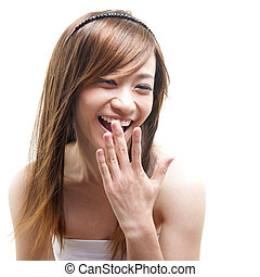 Shocked woman - Laughing Asian woman covering her mouth on...