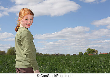 Smiling girl - Portrait of a redhaired girl in a meadow