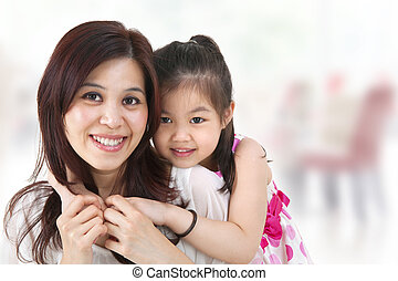 Asian family - Mother and daughterindoor home
