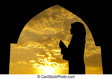 Muslim praying in mosque - Silhouette of Female Muslim...