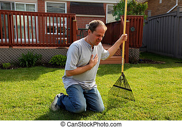 man having chest pains while gardening - man having a heart...
