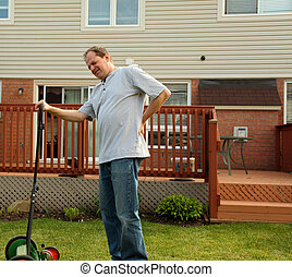 backache while doing yard work - man experiencing backache...