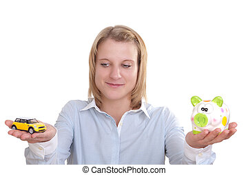 Young woman holds a piggy bank in one and a car in the other hand