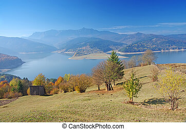 Lake and mountain in autumn - Autumnal landscape with lake...