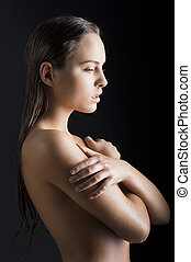beauty girl with wet skin turned in profile - beauty classic...