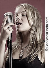 Gorgeous singer and vintage microphone