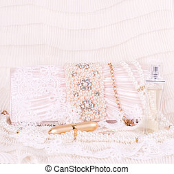 handbag with pearls, perfume bottle