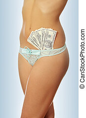 Prostitution concept - woman with cash in panties