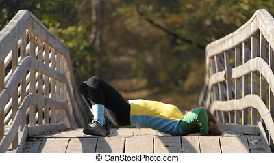 Beautiful girl exercise on a bridge