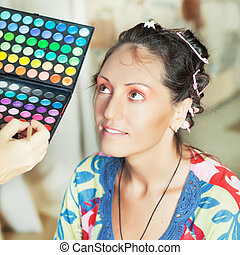 Beauty salon - Woman in beauty salon reading for make-up