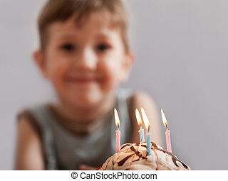 Smiling child with birthday cake candle - Little smiling...