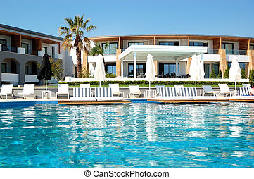 Swimming pool by a beach at the modern luxury hotel, Pieria, Greece