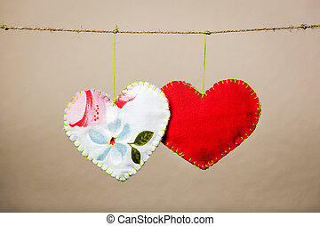 Cotton fabric hearts on the grey background