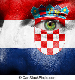 Flag painted on face with green eye to show croatia support