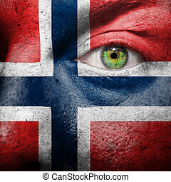 Flag painted on face with green eye to show norway support