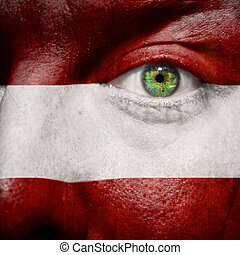 Flag painted on face with Austria eye to show argentina support