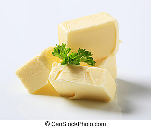 Fresh butter - Blocks of fresh butter and parsley - studio