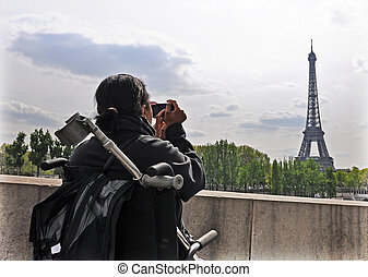 Accessible Paris - A young lady in a wheelchair has a...