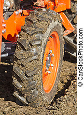 Dirty Tractor Tire - Dirty tractor tire showing wheel entire...