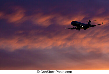Airplane coming in for landing - Airplane landing with...