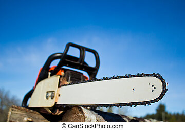 Professional Power Chainsaw - Orange chainsaw with emphasis...