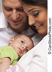 Mixed Race Young Family with Newborn Baby - Happy Young...