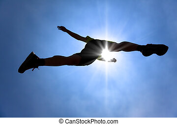 The Silhouette of runner acrossing sky with sunlight background