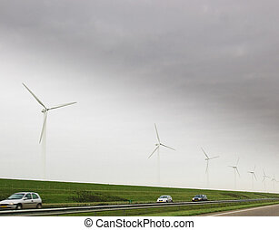 Wind turbines and car on highway