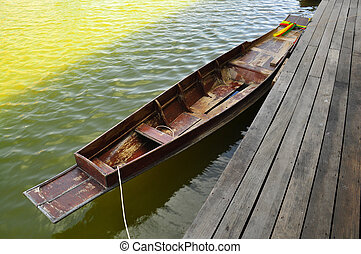 old wood rowboat in Thailand on the water