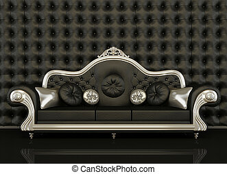 Classic leather sofa with a silver frame on black background...