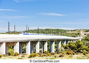 train of TGV on railway viaduct near Vernegues, Provence,...