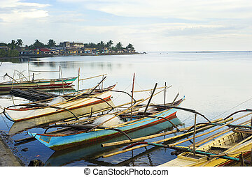 Philippines fishermans boats - Tropical landscape with...