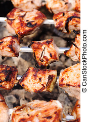 Grilling meat. - Meat are grilled on skewers.