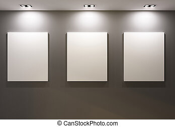 Empty frames on grey wall in gallary of museum interior