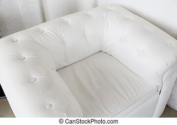 Modern white leather armchair with batton in interior. Top