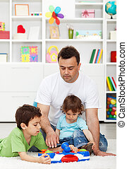 Father spending time with kids at home playing together
