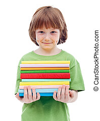 Litlle boy with freckles holding books