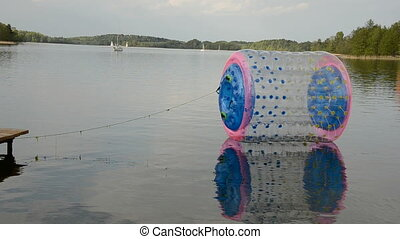zorbing ball on the lake wa - plastic zorbing ball on the...