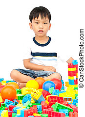 Little boy playing with toy on white background