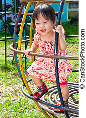 Asian Little girl playing in Playground of Thailand