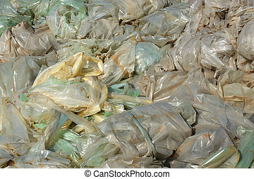 Polyethylene films landfill - Heap of recycled wastes from...