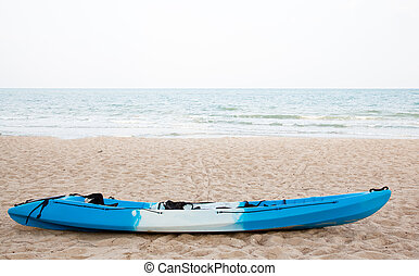 Colourful kayak on the beach
