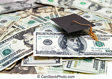 education costs - mini graduation cap on US money --...